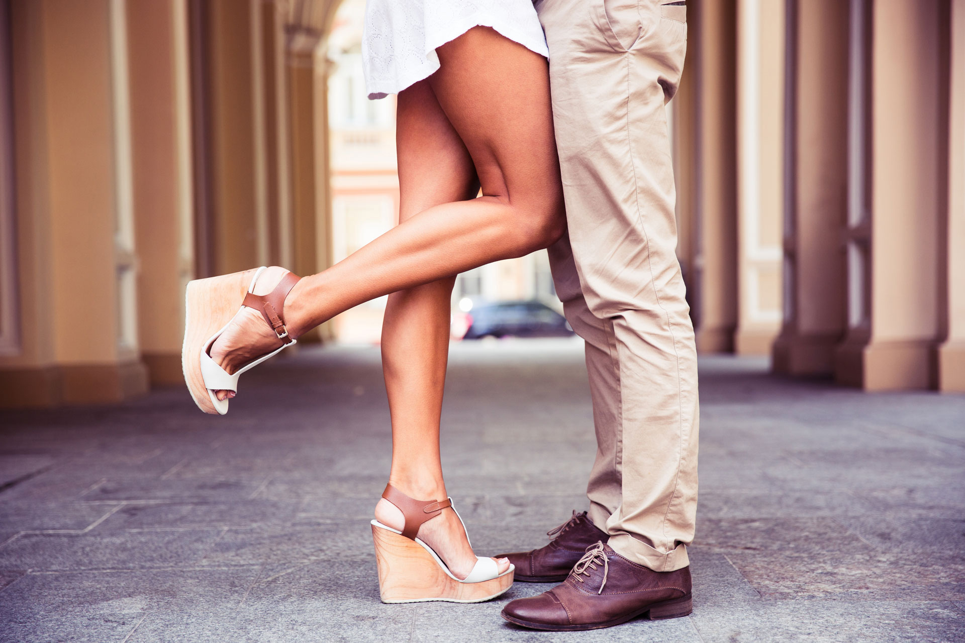 closeup-portrait-of-a-male-and-female-legs-during-a-date_SYzz2PrCBj.jpg